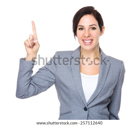 Brunette Businesswoman with finger point up - stock photo