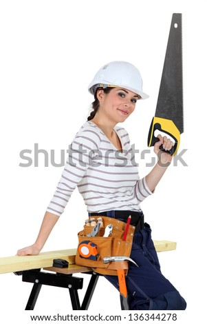 Brunette carpenter with saw - stock photo