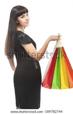 Brunette Caucasian Woman With Shopping Bags. Vertical Image. Isolated Over White - stock photo