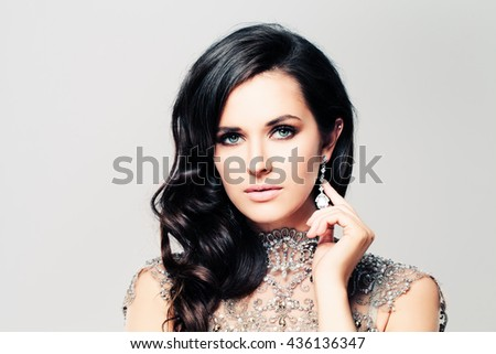Brunette Fashion Model Woman. Curly Hairstyle, Beautiful Face, Makeup and Diamond Jewelry
