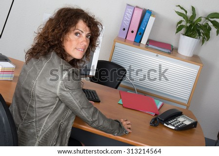 Brunette  female at her desk at office