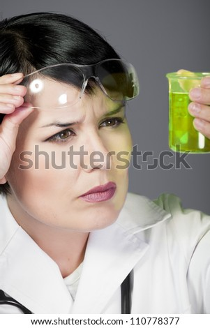 brunette female doctor checking laboratory samples with protective glasses, career women, PHD