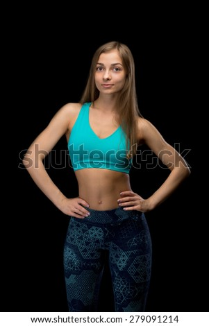 Brunette fitness woman in sportswear. In the studio, isolate on a black background. - stock photo