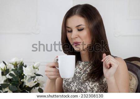 Brunette girl. coffee drinking tea. smile sexy - stock photo