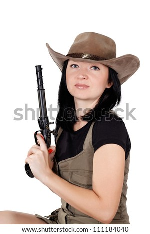 brunette girl in a hat with a gun isolated on white background - stock photo