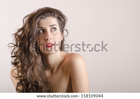 Brunette girl portriat with gray copyspace.