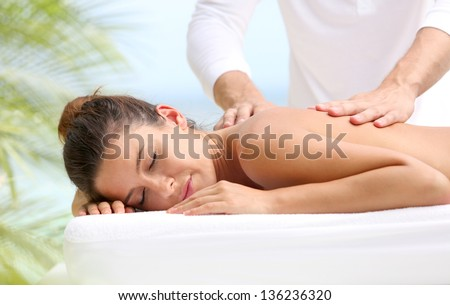Brunette girl receiving a massage - stock photo