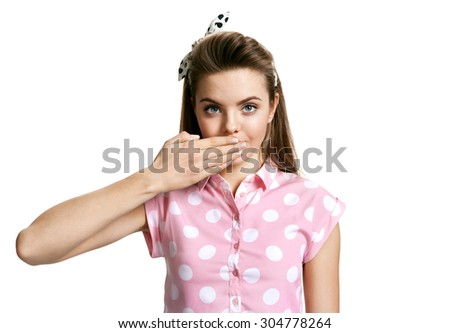 Brunette girl sending air kiss / photo of young cheerful brunette woman over white background, positive emotions