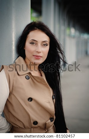 brunette girl waiting for train on platform