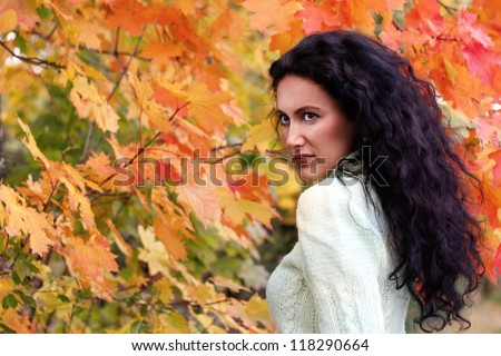 Brunette girl with autumn background