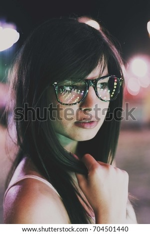 brunette girl with glasses. face portrait