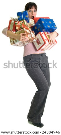 Brunette girl with hands full of gifts. Isolated over white