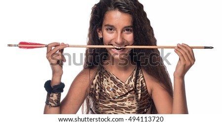 brunette girl with long hair in the Amazon costume with bow and arrow on a white background.