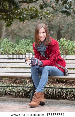 Brunette haired woman in a Forsyth Park. - stock photo
