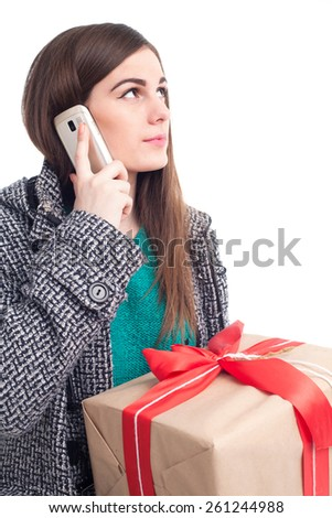 Brunette holding a gift and talking on the phone(isolated on white) - stock photo