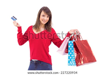 Brunette holding gift and credit card on white background
