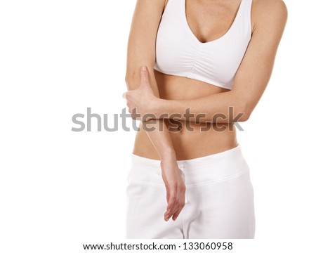 brunette holding her elbow on white isolated background - stock photo