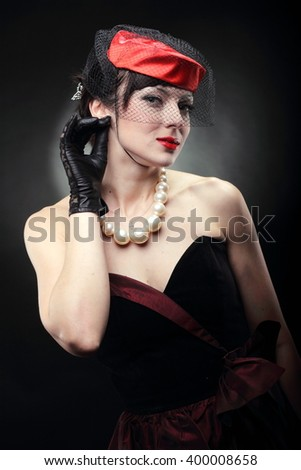 brunette in a red hat - stock photo