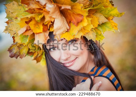 Brunette in autumn leaves