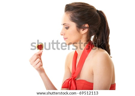 brunette in red dress eat heart shaped cookie, isolated on white - stock photo