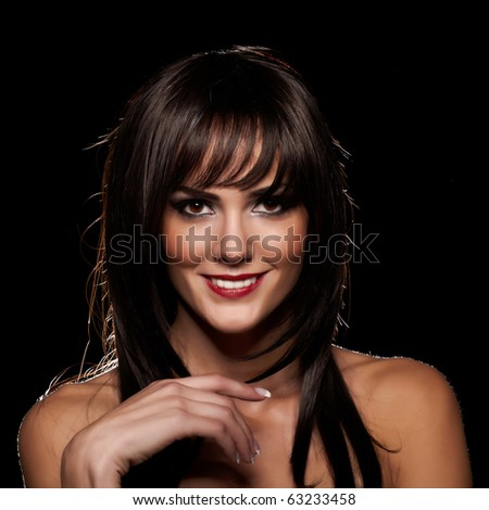 Brunette lady with a beautiful smile isolated on black
