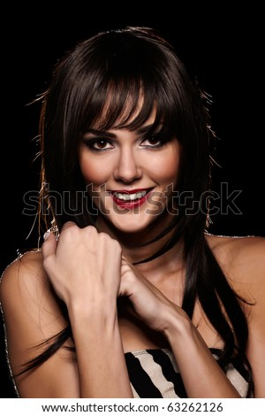 Brunette lady with a beautiful smile isolated on black - stock photo