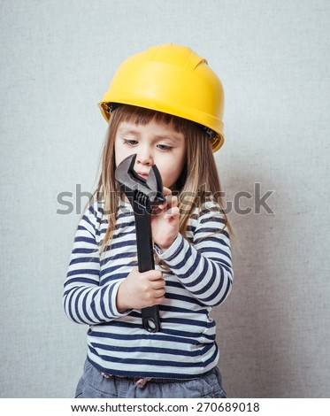 Brunette little girl with a yellow helmet  - stock photo