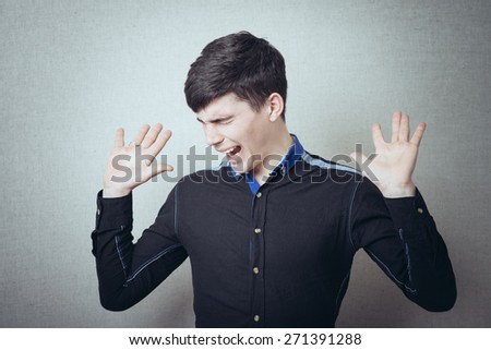 Brunette man his hands up to his arrest - stock photo