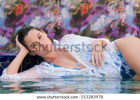 Brunette Model in the shallow end of the swimming pool