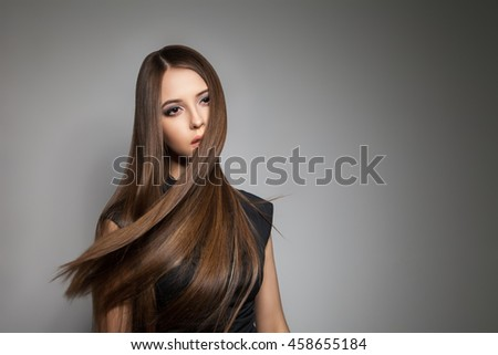 Brunette model with brilliant hair flying away