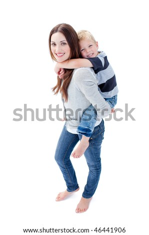 Brunette mother giving her son piggyback ride against a white background