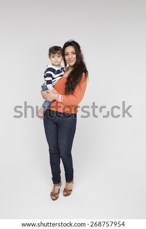 Brunette mother with her child on a white background - stock photo
