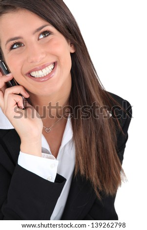 Brunette on the phone - stock photo
