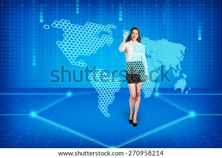 Brunette operating search interface on the wall (Attractive young adults in futuristic interfaces / interiors series)