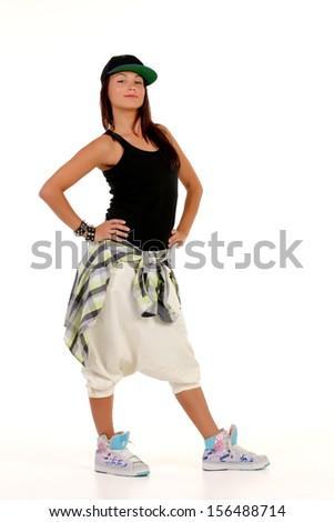 Brunette posing in hip hop outfit