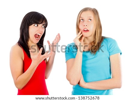 Brunette shouting at her friend - problems. - stock photo
