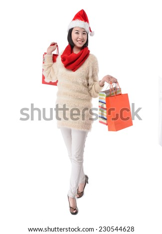 Brunette showing sale bag and shopping bag on white