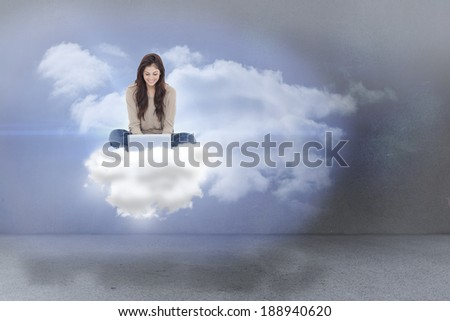 Brunette sitting on cloud using laptop against clouds in a room - stock photo