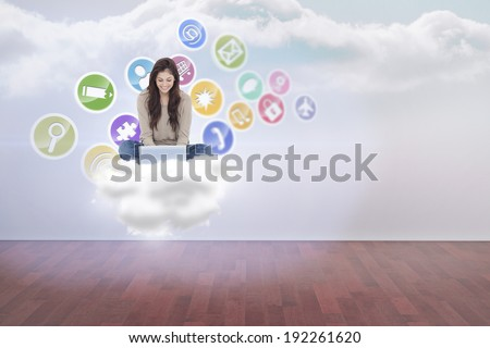 Brunette sitting using laptop against clouds in a room - stock photo