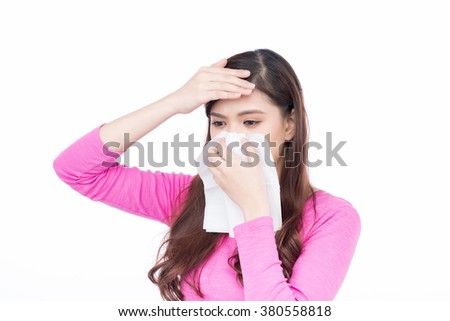 Brunette sneezing in a tissue. Sick Asian Woman.Flu.Woman Caught Cold. Sneezing into Tissue. Headache. Virus .Medicines - stock photo
