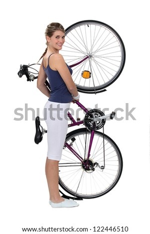 Brunette stood with bicycle - stock photo