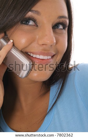 brunette talking on the phone - stock photo