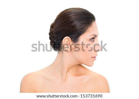 Brunette turning her head to the right and looking on white background