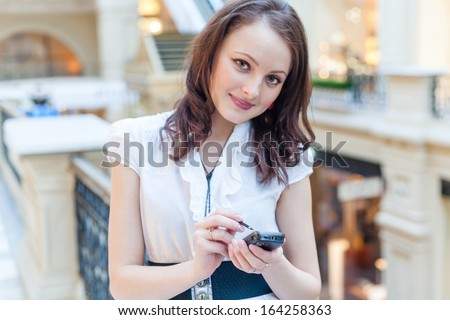 brunette using cell phone indoor