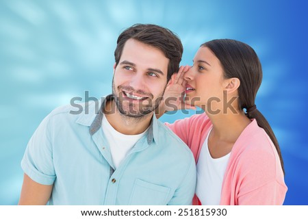 Brunette whispering secret to her boyfriend against valentines heart design - stock photo