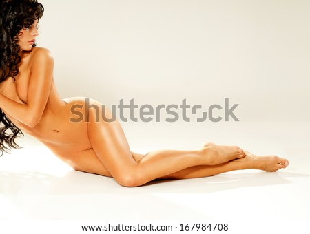 Brunette  with a beautiful figure and luxurious curly hair - stock photo