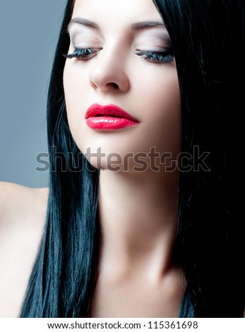 Brunette with perfect hair and red lipstick - stock photo