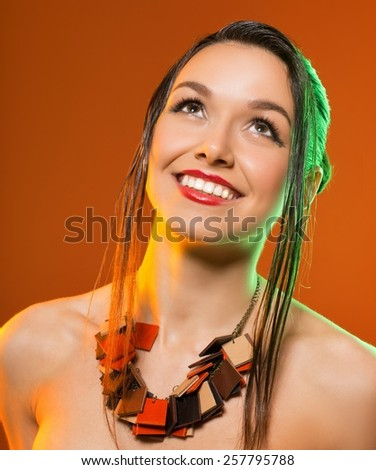 brunette with stylish haircut looks away - stock photo