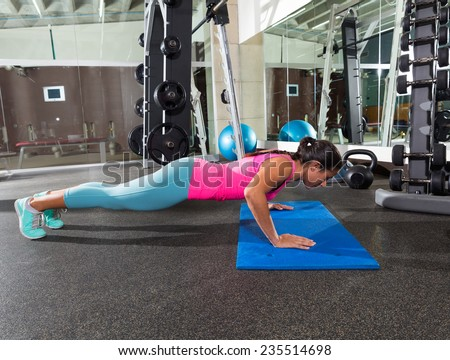 brunette woman at gym push up push-up workout exercise - stock photo