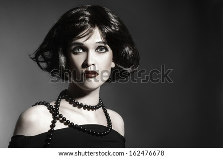Brunette woman black hair style. Elegant woman hairstyle portrait